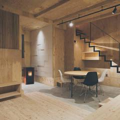 集う家/リノベーション: 一級建築士事務所 Atelier Casaが手掛けたリビングです。