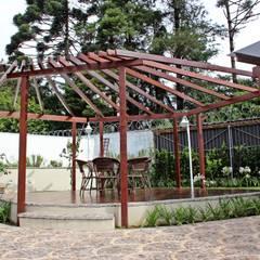 Residência IM: Jardins clássicos por Alexandre Mandarino Arquiteto