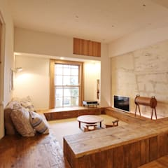 Apartment in tamagawa: Mimasis Design/ミメイシス デザインが手掛けたリビングです。