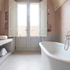 Baños de estilo  por architetto stefano ghiretti