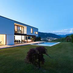 Exteriores con encanto: Casas prefabricadas de estilo  de DonStudio