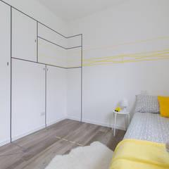 Home staging di un appartamento in nuova costruzione: Stanza dei bambini in stile in stile Moderno di Home Staging & Dintorni