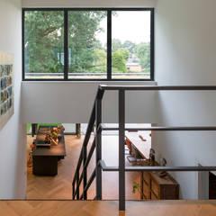 :  Corridor & hallway by JADE architecten, Modern