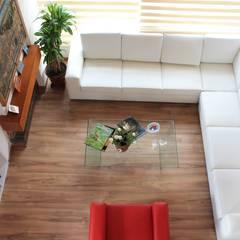 Vista área social: Salas de estilo  por ATELIER HABITAR