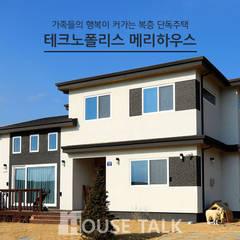 클래식건축스타일 전원주택: 하우스톡의  주택