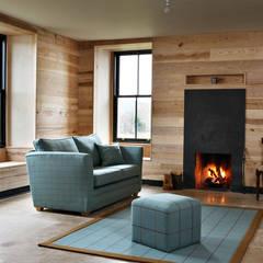 Internal Olive Ash Cladding:  Living room by Ben Sutton (Timber) Ltd