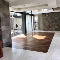 Modern living room by GRUPO VOLTA Modern Marble