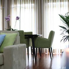 Zona de jantar: Salas de jantar  por Perfect Home Interiors