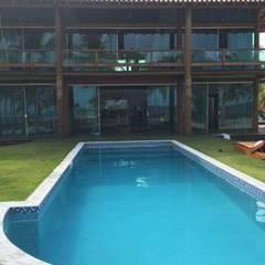 Residencia 02 num Condominio na praia: Chalés e casas de madeira  por Arquitetura & Design - Marcela Tavares