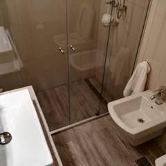 Reforma Integral en Recoleta: Baños de estilo minimalista por Construye Tu Proyecto