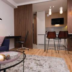 Zdjęcie salonu z widokiem na aneks kuchenny: styl , w kategorii Kuchnia zaprojektowany przez Viva Design - projektowanie wnętrz