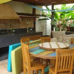 Salas de jantar tropicais por homify