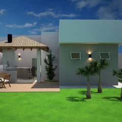 Vista da área de lazer com churrasqueira: Casas familiares  por Arquiteta Bianca Monteiro