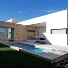 Single family home by linkehome arquitectura, Mediterranean Stone