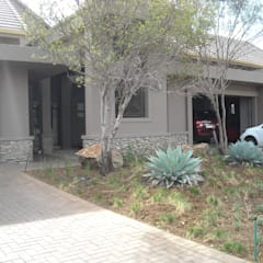 Structural Finishes to Meyersdal Eco Estate Villa Eclectic style houses by CKW Lifestyle Associates PTY Ltd Eclectic
