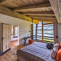 Wohnen am See | Schlafzimmer:  Schlafzimmer von UNA plant