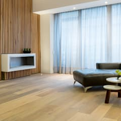Sala apartamento en Bogota: Salas de estilo escandinavo por Pisos Millenium