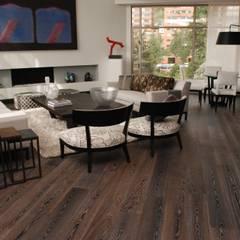Sala apartamento en Bogota: Salas de estilo  por Pisos Millenium