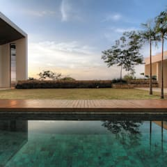 Casa Americana: Casas familiares  por Olaa Arquitetos