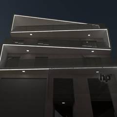 FACHADA NOCTURNA: Casas multifamiliares de estilo  por GS TALLER DE ARQUITECTURA