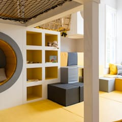 The timber structure offers seating, storage, play and more.:  Nursery/kid's room by Tigerplay at Home