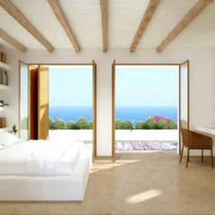Vivienda Unifamilar - Ibiza - España: Dormitorios de estilo mediterraneo por MADBA design & architecture