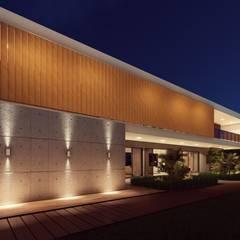 Fachada com elementos industriais e rústicos: Casas pré-fabricadas  por Vortice Arquitetura