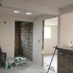 Recubrimientos  y acabado en muros de casa habitación.: Paredes de estilo  por GA+ST CONSTRUCCIÓN PROYECTOS  E INGENIERÍA DE COSTOS