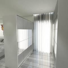 Moradia em LSF (AFM): Closets  por Idealiving