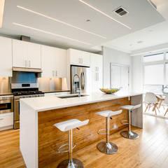 Divis Condo: modern Kitchen by KUBE Architecture