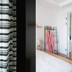 가족의 개성을 담은 거울 같은 집_광교한양수자인인테리어 : (주)바오미다의  침실