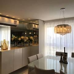 Apartamento 09: Salas de jantar ecléticas por P.B Arquitetura