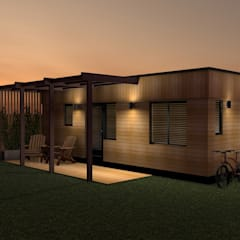 Exterior Evening:  Prefabricated home by Building With Frames