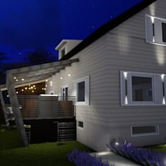 Fachada lateral noturna: Casas familiares  por Studio²