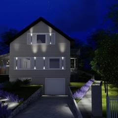 Fachada frontal noturna: Casas familiares  por Studio²
