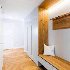 Penthouse Maxvorstadt:  Flur & Diele von BESPOKE GmbH // Interior Design & Production