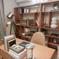 Home Office: Escritórios  por Cassia Espada Arquitetura