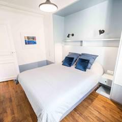 Rénovation d'un appartement Haussmannien: Chambre de style  par Clo - Architecture & Design