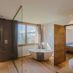 EFH Flütsch in Pany:  Badezimmer von architetta schiers ag