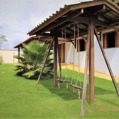 Projekty,  Dom rustykalny zaprojektowane przez Ativo Arquitetura e Consultoria