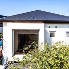 제주 두모리 주택: 더 이레츠 건축가 그룹의  창문