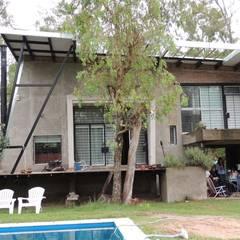 Casa A&P - Vista 3: Jardines en la fachada de estilo  por Módulo 3 arquitectura