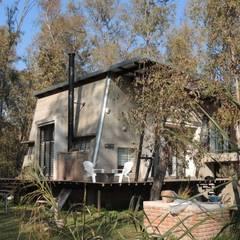 Casa A&P - Vista 6: Jardines en la fachada de estilo  por Módulo 3 arquitectura