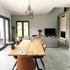 Maison L02: Salle à manger de style  par 3B Architecture