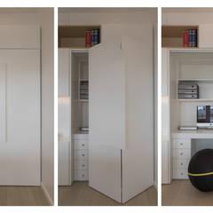 """Casa """"FG"""" bianco scolpito: Studio in stile in stile Moderno di MAMESTUDIO"""