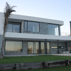 Detached home by CIBA ARQUITECTURA,