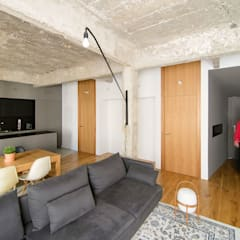 Casa FC25: Salones de estilo  de Garmendia Cordero arquitectos