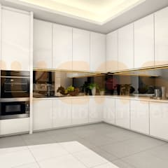 double storey house in cheras:  Built-in kitchens by Yucas Design & Build Sdn. Bhd.