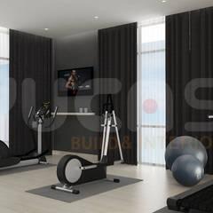 Gimnasios en casa de estilo  por Yucas Design & Build Sdn. Bhd.