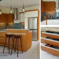 Modern Modular Kitchen:  Kitchen by Kat Interior and Design,